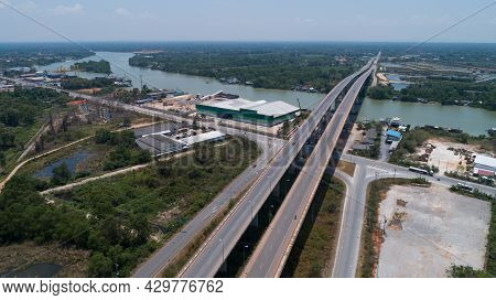 Drone View Top Down Of Tapee River And Bridge In Surat Thani Thailand