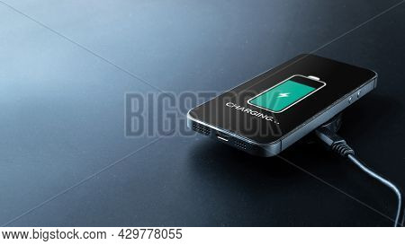 Smartphone Charging. Mobile Cell Phone Charge Battery From Wireless Inductive Charger. Electronic De