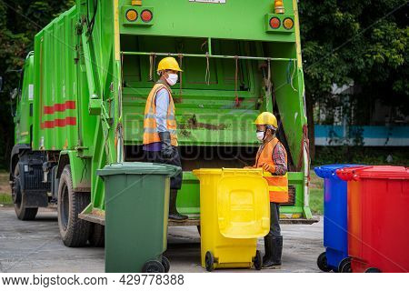 Garbage Collection Service,rubbish Cleaner Man In A Uniform Working Together On Emptying Dustbins Fo