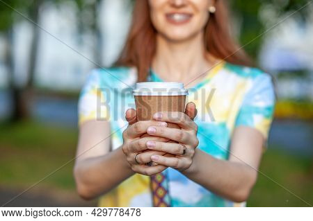 White Paper Cup With Coffee In Woman Hand. Time For Drink Coffee In City. Coffee To Go. Enjoy Moment