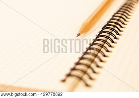 Close-up Notebook Or Note Book Diary With A Pencil On Wooden Desk Or Boardroom Table For Meeting Not