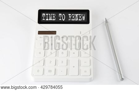 Time To Renew Business Text On Calculator With Pencil