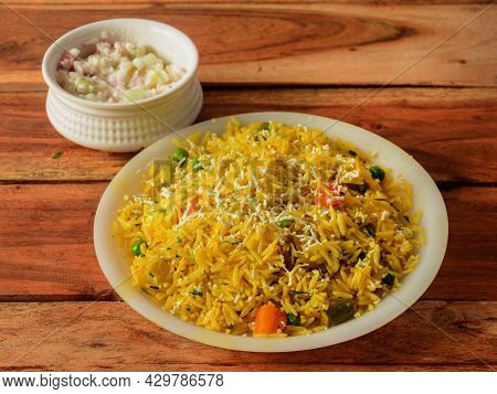Veg Pulao Cooked With Masala Spices, Served Over A Rustic Wooden Background, Selective Focus