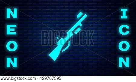 Glowing Neon Hunting Gun Icon Isolated On Brick Wall Background. Hunting Shotgun. Vector