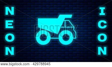 Glowing Neon Mining Dump Truck Icon Isolated On Brick Wall Background. Vector