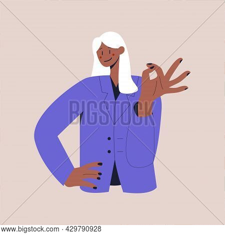 A Happy Black Woman In A Business Suit Shows The Ok Sign. The Ok Gesture. Colorful Flat Vector Illus