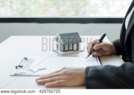 Agents Working In Real Estate Investment And Home Insurance Signing Contracts In Accordance With The