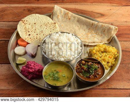 Indian Hindu Veg Thali / Food Platter Consists Variety Of Veggies, Lentils, Sweet Dish, Snacks Etc.,