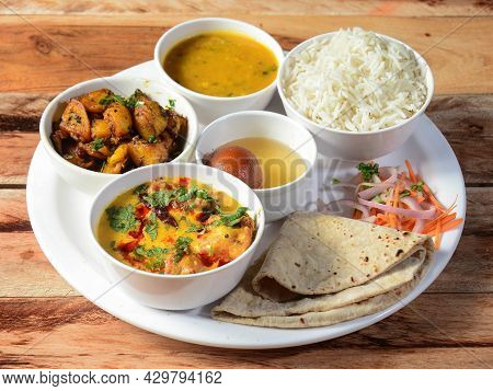 Indian Veg Rajasthani Thali / Food Platter Consists Variety Of Veggies, Lentils, Sweet Dish, Snacks