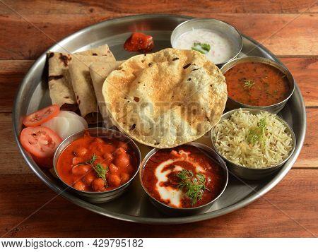 Punjabi Veg Thali From An Indian Cuisine, Food Platter Consists Variety Of Veggies, Lentils, Jeera R