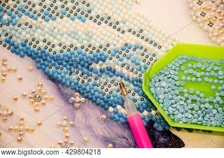 Diamond Painting Embroidery Craft. Acrylic Rhinestones And Pen Tool. Closeup, Selective Focus.