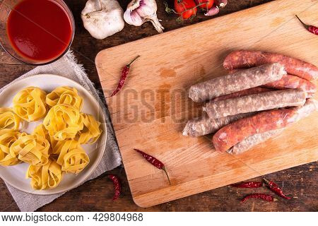 Cooking American Pasta With Sausage Stew, Pasta With Sausage Ragu.  Ingredients On The Table - Two T