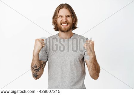 Cheerful Blond Man Chanting, Smiling Excited, Feeling Lucky, Winning Something, Triumphing From Rejo
