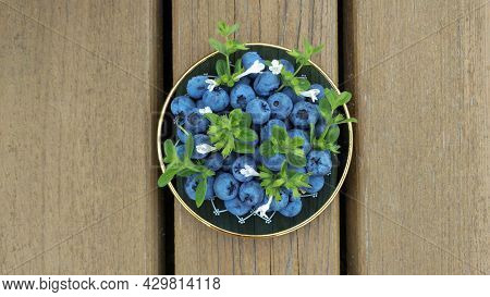 Blueberries And Small Sprigs Of Lemon Balm Mint In A Beautiful Plate. New Eco Harvest.