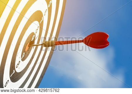 Close Up Shot Red Darts Arrows In The Target ,arrow Hitting The Center Of A Shooting Target For Busi