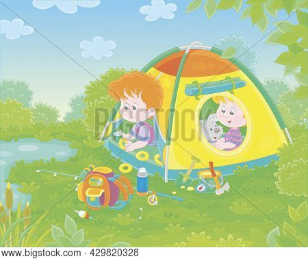 Cheerful Little Kids Tourists With A Merry Pup Resting In Their Colorful Camp Tent By A Pretty Small