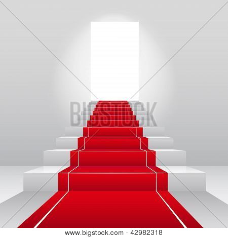 Stairs with red velvet carpet.