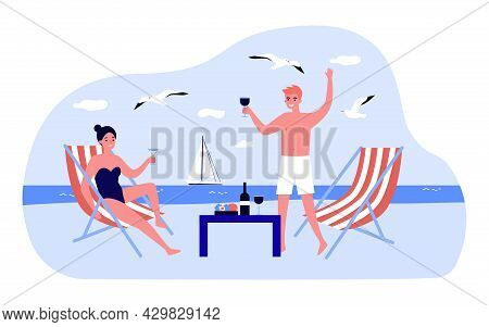 Happy Young Couple Drinking Wine On Beach. Boyfriend And Girlfriend Having Romantic Dinner By Sea Fl