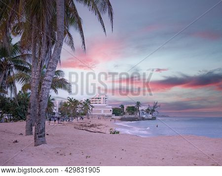 San Juan, Puerto Rico. January 2021. People Is Resting On San Juan's Ocean Park Beach After A Day's