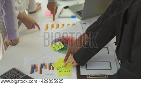 Business People Proficiently Discuss Work Project On Meeting Table . Corporate Business Team Collabo