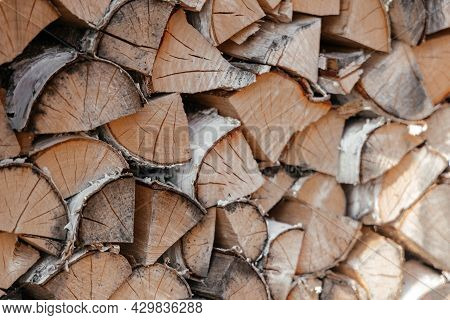 Pile Of Firewood Toned Texture Background. Preparation Of Firewood For The Winter For Cooking, Kindl