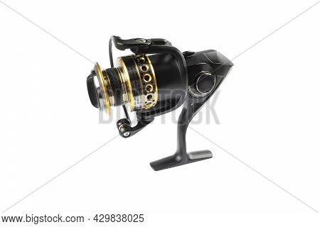 Fishing Tackle. Fishing Reel Isolated On White Background With Clipping Path. Modern Fishing Reel Is