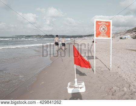 Sariyer, Istanbul, Turkey - 07.17.2021: Red Warning Flag With Text Saying Forbidden And Dangerous Pl