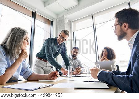 Male Mature Caucasian Ceo Businessman Leader With Diverse Coworkers Team, Executive Managers Group A