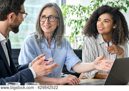 Happy Diverse Business People Group Negotiating Business Strategy At Boardroom Meeting Table Using L