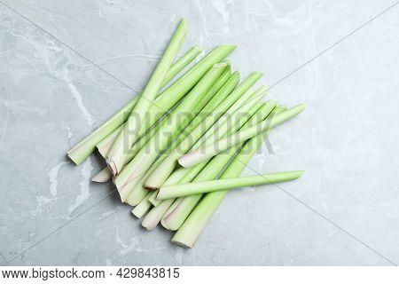 Fresh Lemongrass Stalks On Light Grey Marble Table, Flat Lay