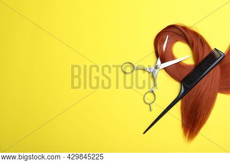 Professional Hairdresser Scissors, Comb, Hair Strand And Space For Text On Yellow Background, Flat L
