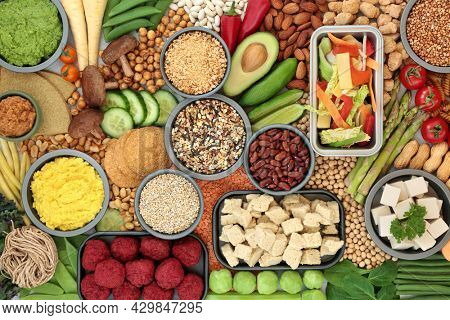 Low cholesterol vegan plant based health food high in antioxidants, protein, vitamins, minerals, fibre, anthocyanins, lycopene and omega 3. Healthy foods also lower blood pressure. Flat lay.