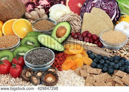 Immune system boosting organic vegan health food collection high in protein, omega 3, vitamins, minerals, antioxidants, anthocyanins, fibre. Healthy eating, save the planet concept.