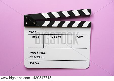 Movie Clapper On Pink Table Blackground ; Film, Cinema And Video Photography Concept