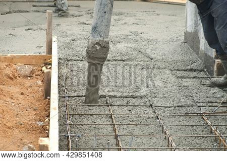Construction Work, Worker Pouring The Foundation Of A Multi-storey Building On Construction Site. Ma