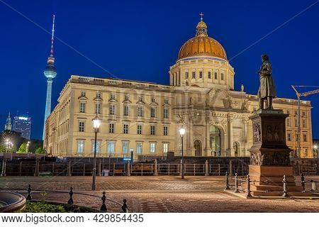 The Beautiful Reconstructed City Palace And The Famous Tv Tower In Berlin At Night