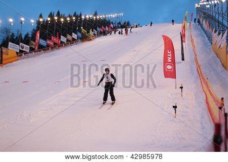 BUKOVEL, UKRAINE - FEBRUARY 23: Denis Osipau, Belarus performs speed check during Freestyle Ski World Cup in Bukovel, Ukraine on February 23, 2013