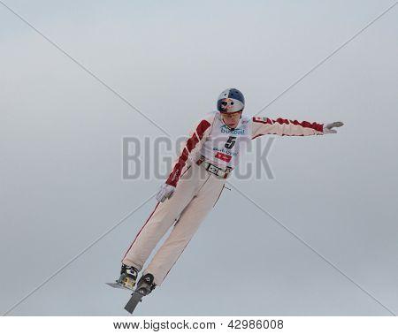 BUKOVEL, UKRAINE - FEBRUARY 23: Travis Gerrits, Canada performs aerial skiing during Freestyle Ski World Cup in Bukovel, Ukraine on February 23, 2013