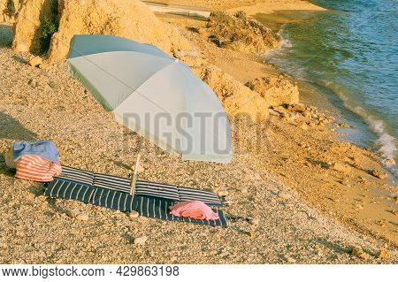 Beach Umbrella For Relax And Comfort On Sea Coast. Happy Summer Vacations And Resort Concept. Seasca
