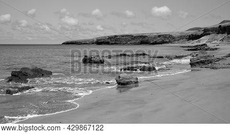 Wild Beach With Calm Sea, Coast Of Jandia, South Of Fuerteventura, Canary Islands