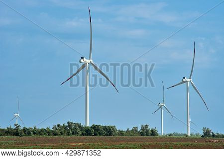 Wind Farm With High Wind Turbines For Generation Electricity. Windmill Park Alternative Energy. Wind