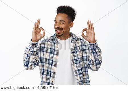 No Problem. Confident Smiling African American Guy Assure All Under Control, Winking And Showing Oka