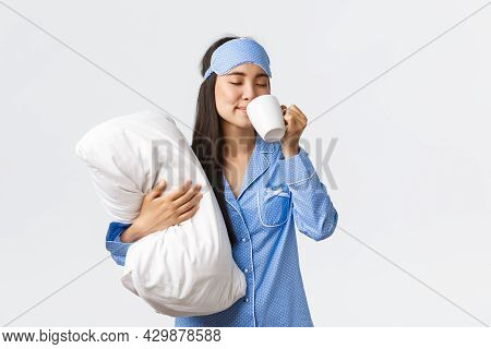 Morning Lifestyle, Breakfast And People Concept. Smiling Beautiful Asian Girl In Pyjamas And Sleepin