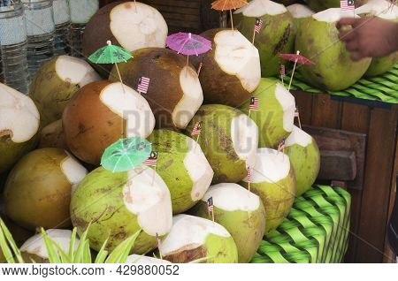 Coconut Drinks With The Malaysian Flag And Umbrella For Sale In A Market Within The Kasturi Walk Sho