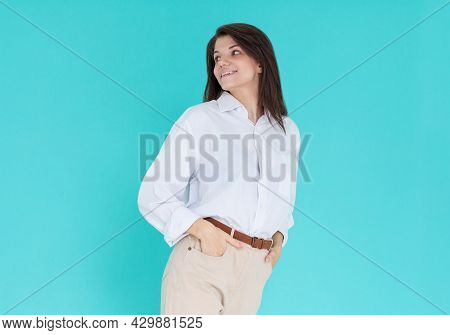 Young Business Woman Isolated On Blue Background. Beautiful Woman In A Shirt Look Sensual. Brunette
