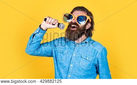 He Is Talanted. Guy With Beard Sing In Microphone. Brutal Caucasian Hipster Event Manager. Funny Par