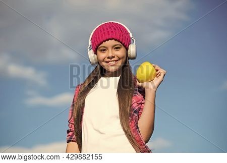The Best Way To Take Your Vitamins. Happy Child Hold Apple On Sunny Blue Sky. Vitamin Snack. Eating