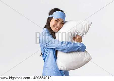 Cute Smiling Asian Girl With Clean Skin, Wearing Sleeping Mask And Pyjama Ready For Bedtime Sleepove