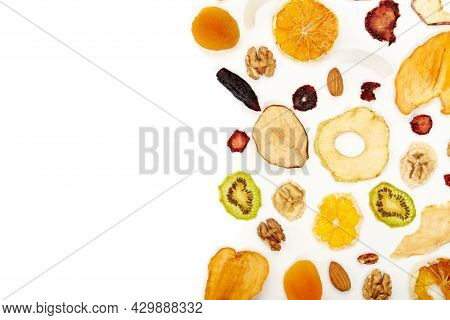 Above View Of Neatly Stacked Dried Fruit Different Colors And Almonds, Orange, Dried Apricot, Raisin