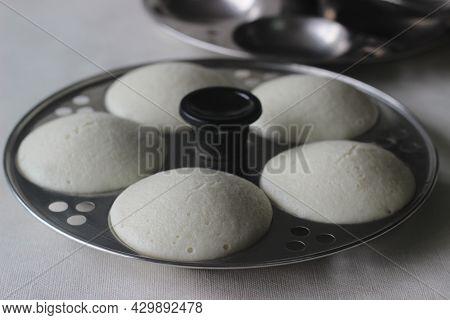 Steamed Rice Lentil Cake Inside The Mould. Steamed Rice Cake Is Popularly Known As Idly In India. Th